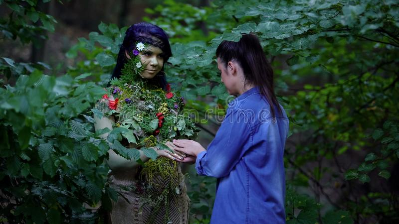 Young woman meeting mother earth in forest, nature unity, safe environment. Young women meeting mother earth in forest, nature unity, safe environment, stock stock images