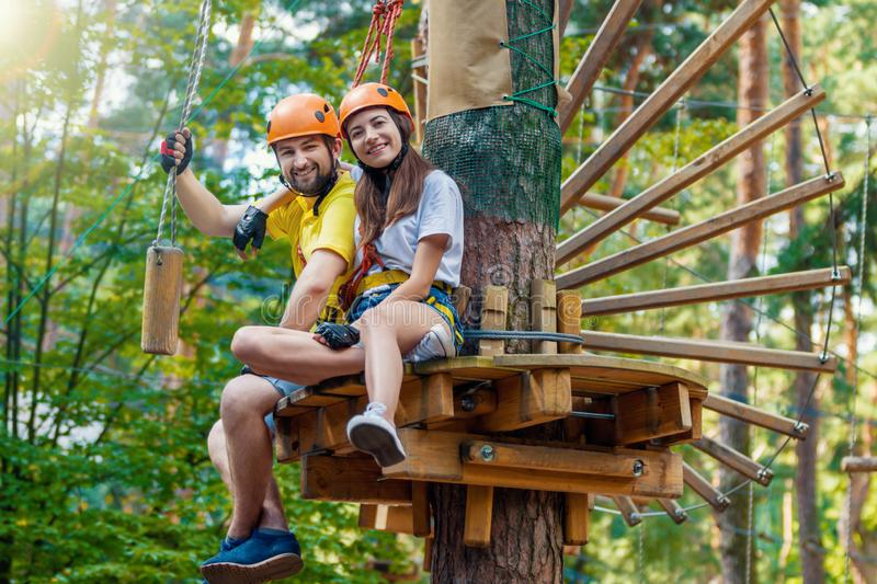 Couple in love enjoy active leisure in extreme rope park stock photo