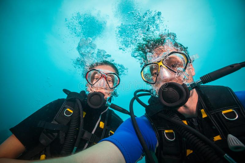 Young woman and man scuba divers making selfie stock images