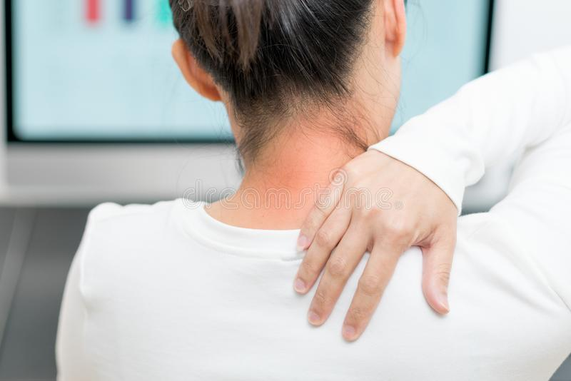 Young women neck and shoulder pain injury with red highlights on pain area, healthcare and medical concept. Young woman neck and shoulder pain injury with red stock photography