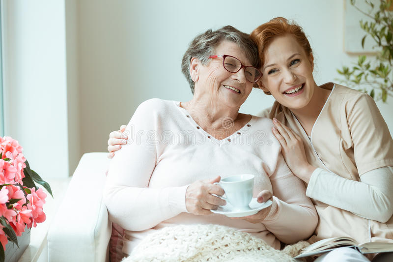 Woman hugging her friend royalty free stock images