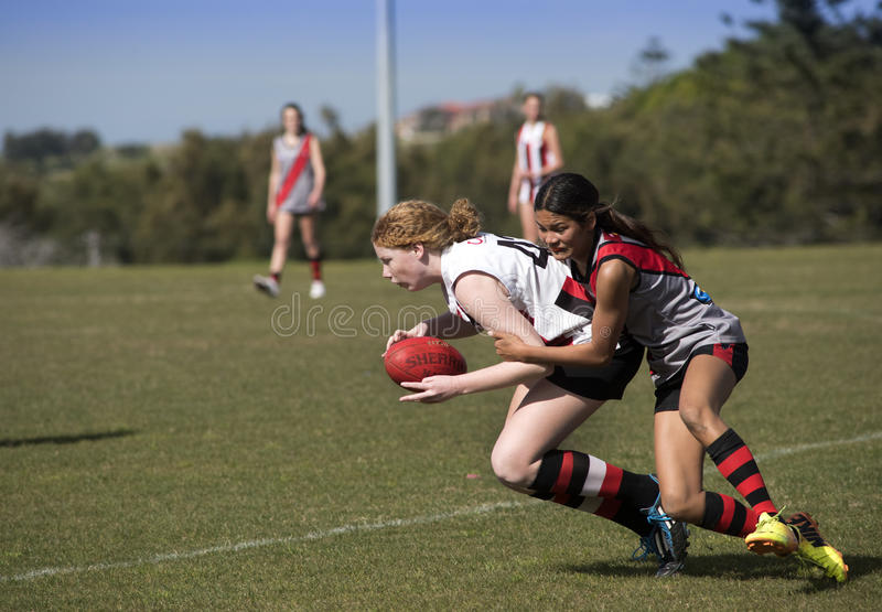 Young women play Australian Rules Football royalty free stock photo