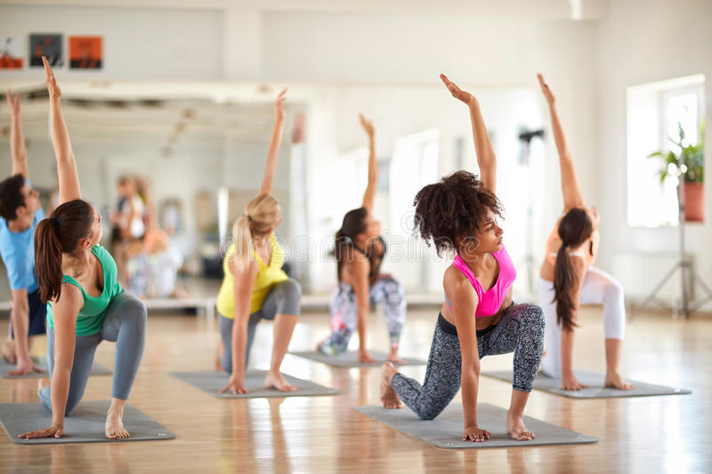 Young women practicing yoga exercises royalty free stock photography