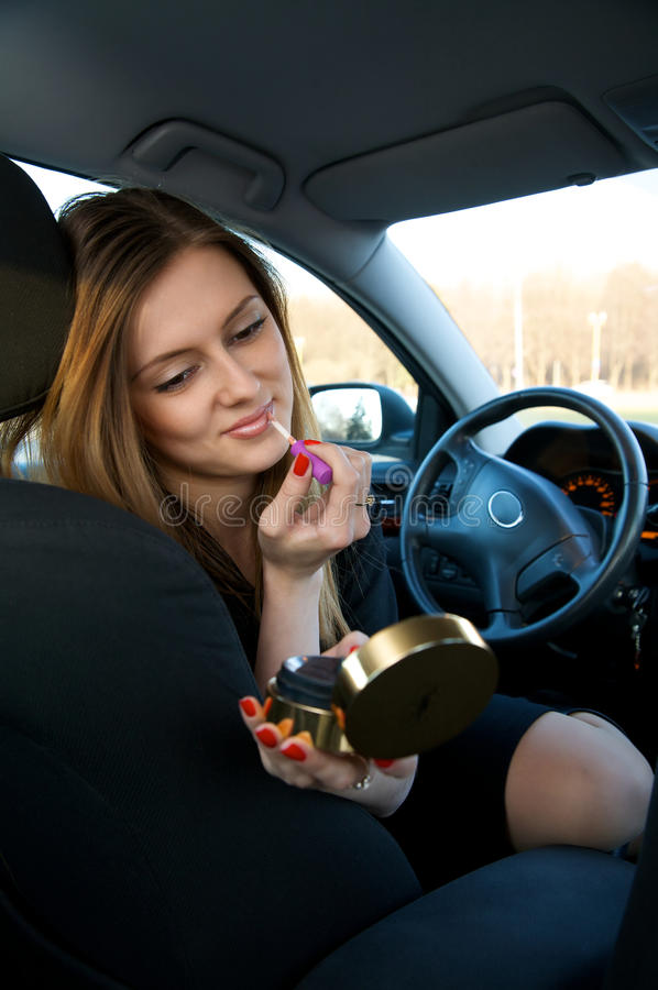 Download Young Women Preparing Her Make-up In Car Stock Image - Image: 11148689