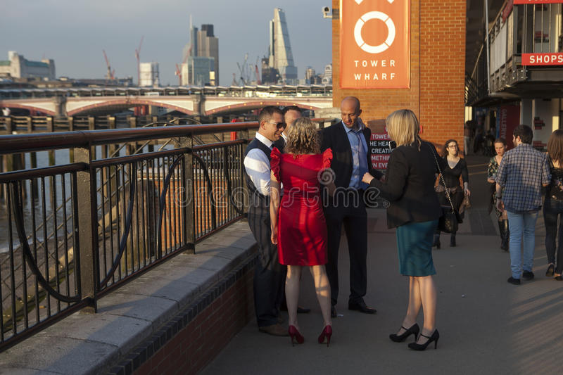 Young women, professional couple enjoying sun and drinks at South Bank, London stock photo