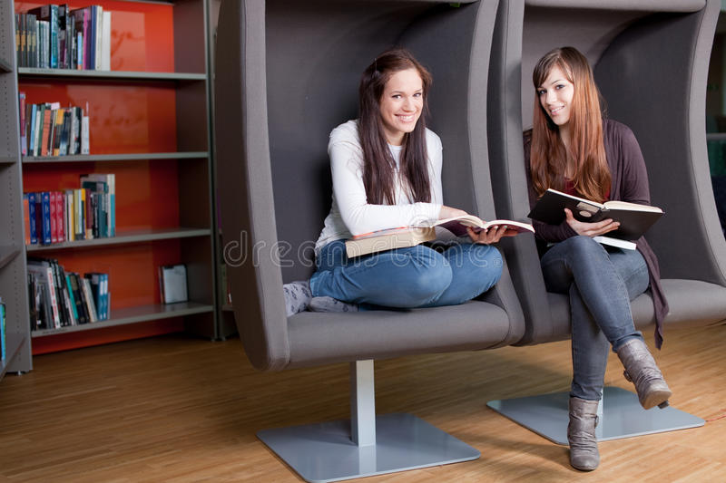 Download Young Women Reading Books Royalty Free Stock Photography - Image: 22839587