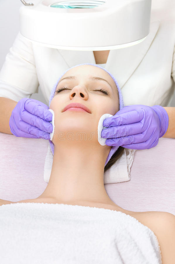 Young woman receiving beauty therapy royalty free stock images