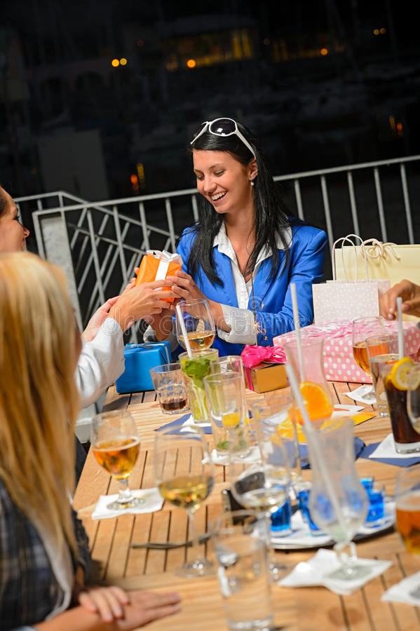 Young woman receiving gifts for her birthday royalty free stock photo