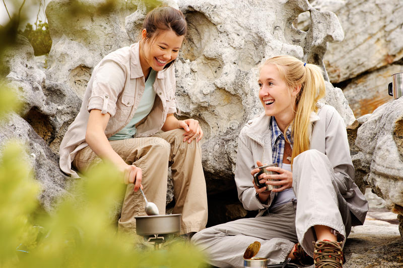 Young women relaxing after a days hike royalty free stock photos