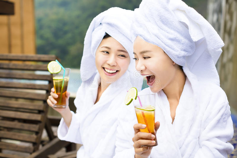 Young Women relaxing and drinking tea after spa royalty free stock photo