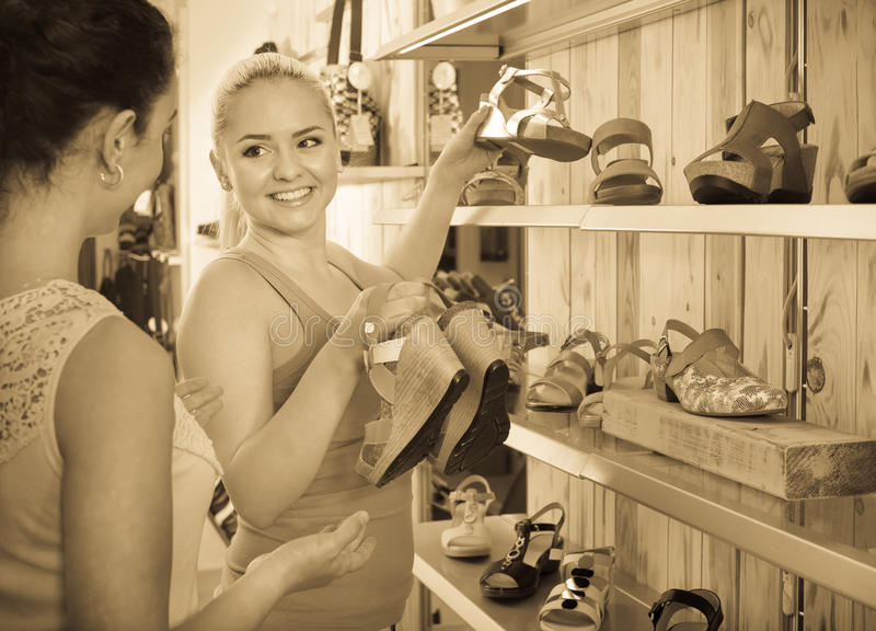 Young women selecting shoes royalty free stock photo