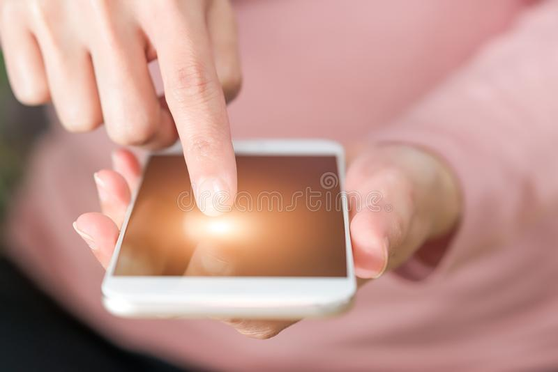 Young women shopping online on smartphone. business and modern lifestyle concept stock photo