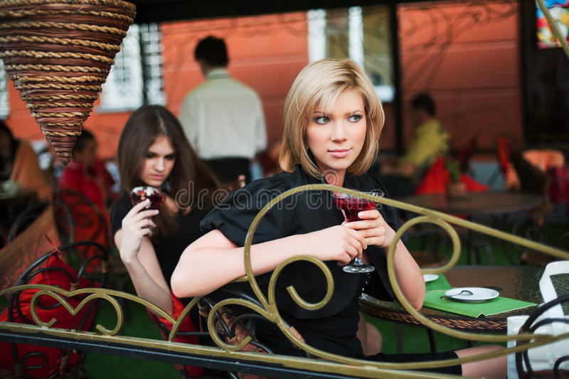 Young Women At Sidewalk Cafe Royalty Free Stock Photography