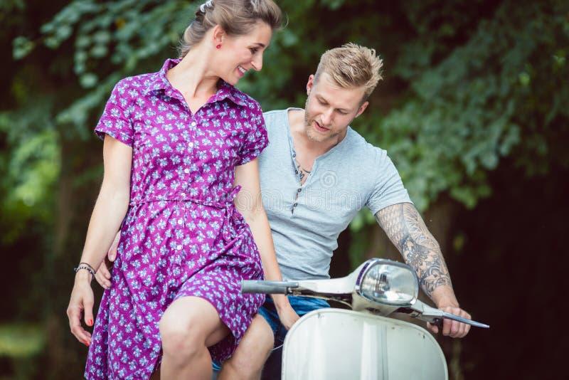 Woman sitting on her boyfriend`s lap royalty free stock photo
