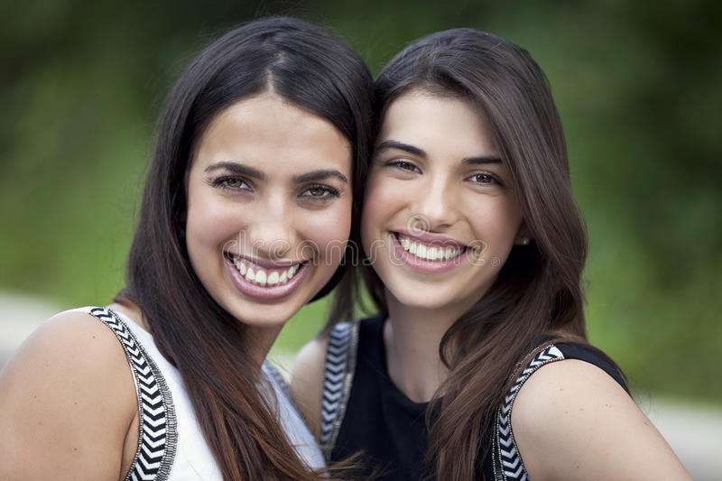 Young women smiling at the camera royalty free stock images
