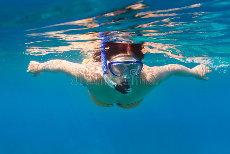 Download Young Women Snorkeling In The Blue Sea Stock Photo - Image: 29628506