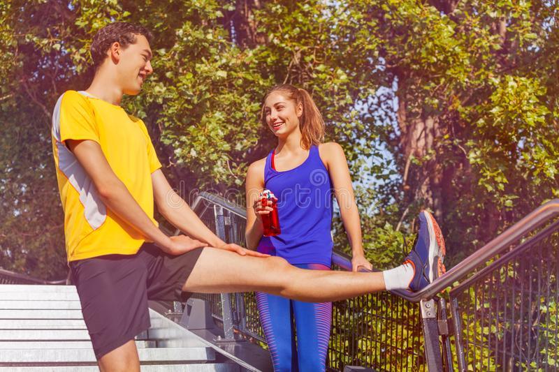 Sporty people preparing to jog in summer park stock photo