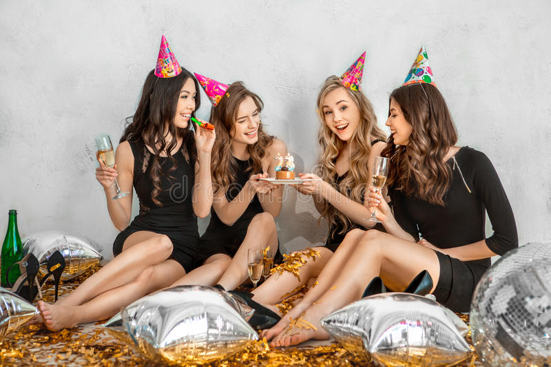 Young women together celebrating birthday isolated on white stock photography