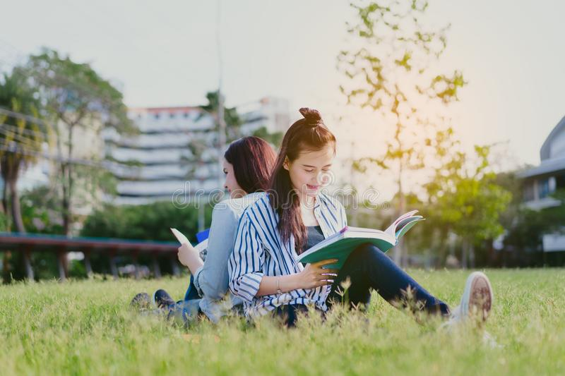 Young women together study reading book stock images