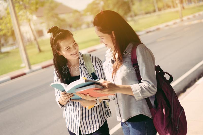 Young women together study reading book stock photography