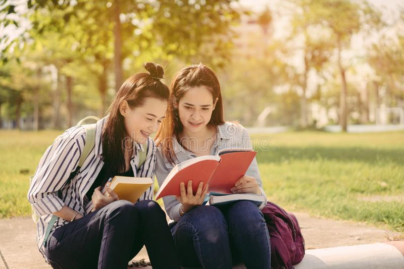 Young women together study reading book stock image