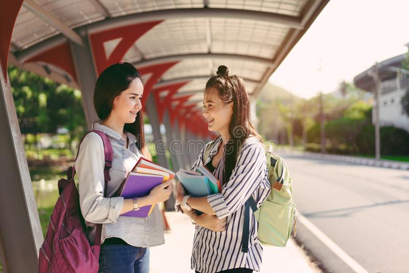Young women together study reading book stock photo