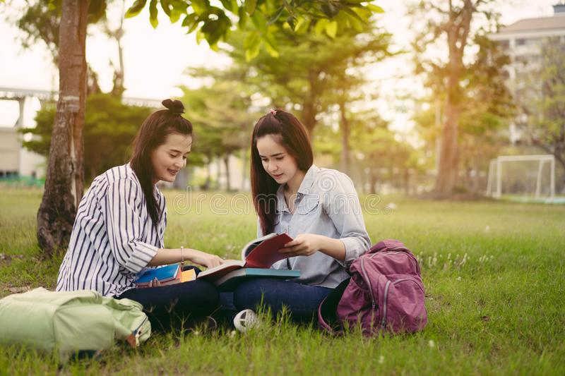 Young women together study reading book royalty free stock photography