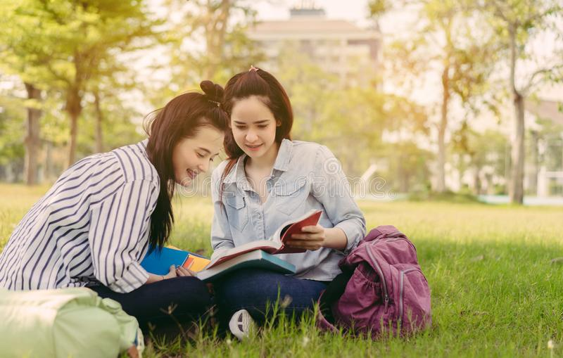 Young women together study reading book royalty free stock photos