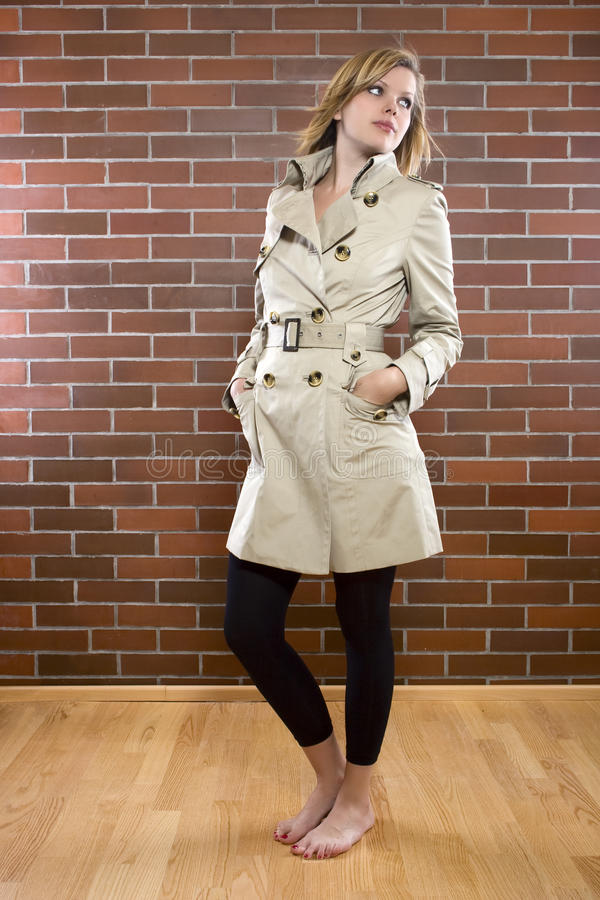 Young women in a trenchcoat stock photos