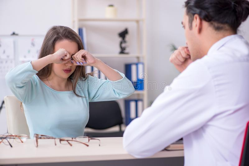 Young woman visiting male doctor oculist royalty free stock photo