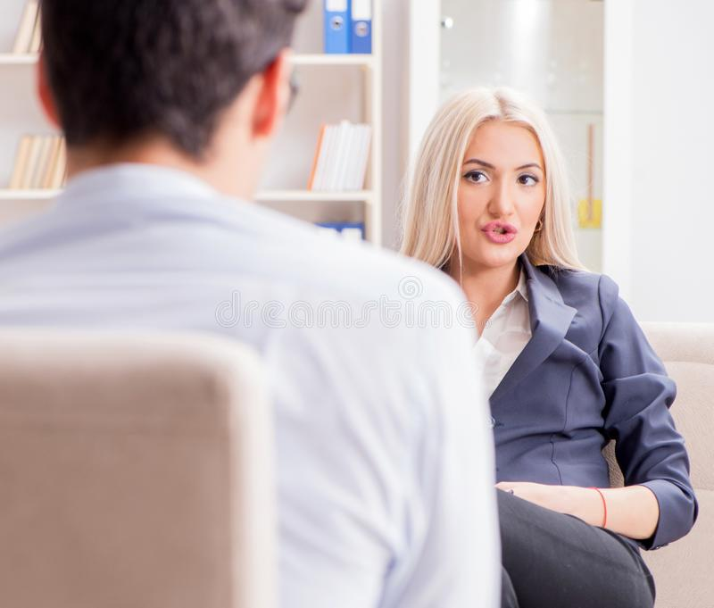 Young woman visiting psychiatrist man doctor for consultation. The young women visiting psychiatrist men doctor for consultation stock images