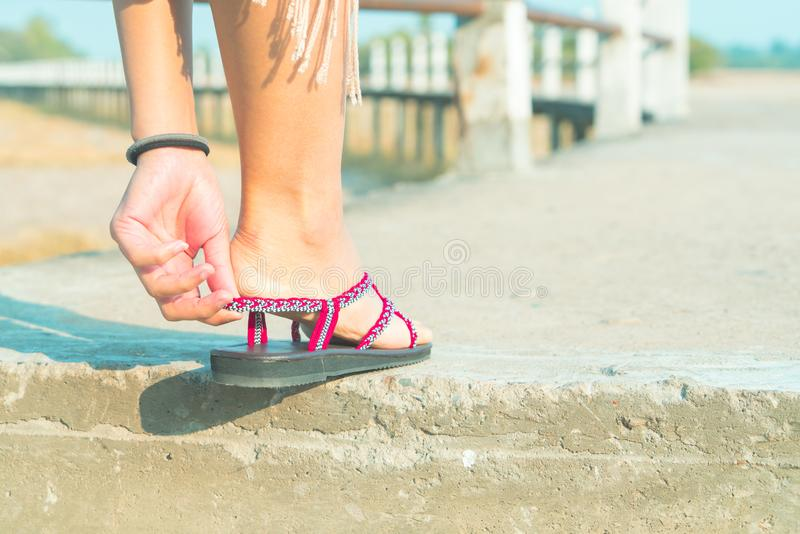 The young women is wearing the casual shoe on the long walking path royalty free stock photography