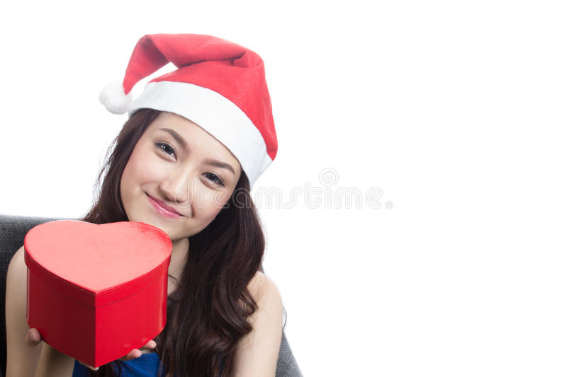 Young women wearing Christmas hats. Young woman wearing Christmas hats look beautiful royalty free stock images