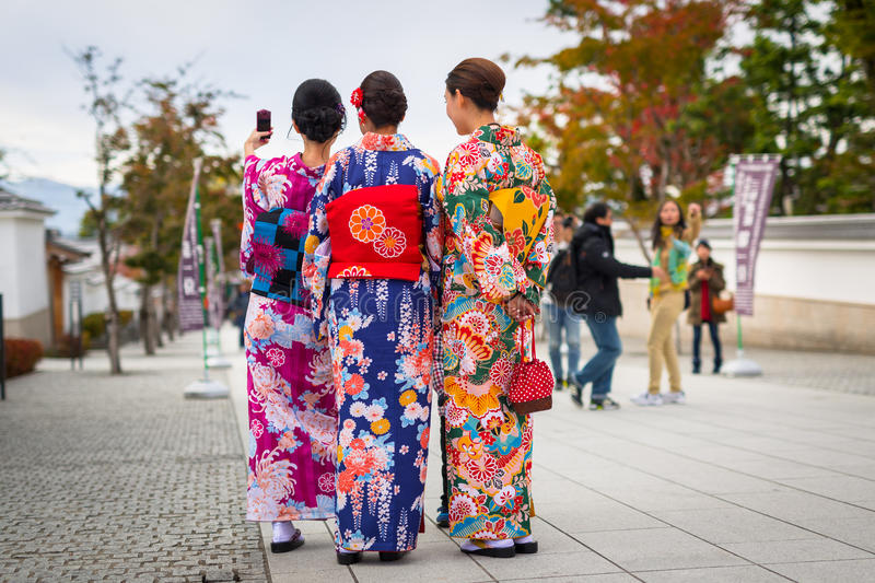Young women wearing traditional japanese kimonos stock images
