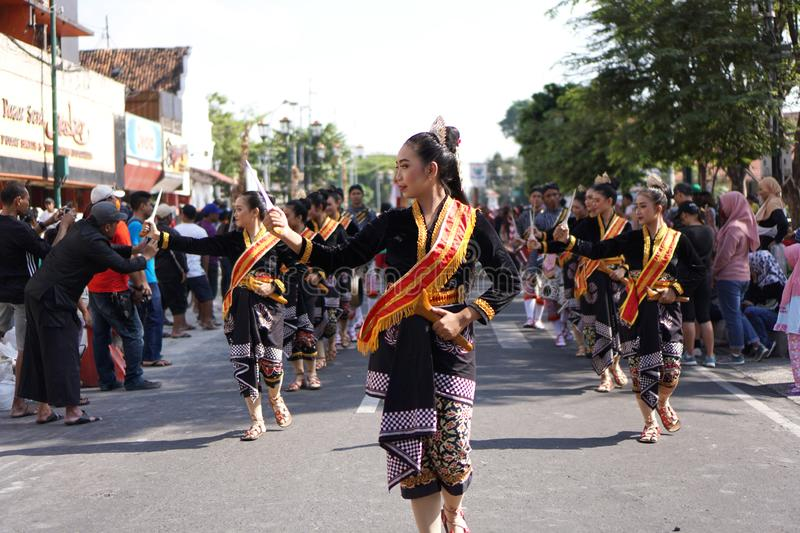 Young women wearing traditional Javanese costumes are parading on the Malioboro Street, Yogyakarta, Indonesia. stock images
