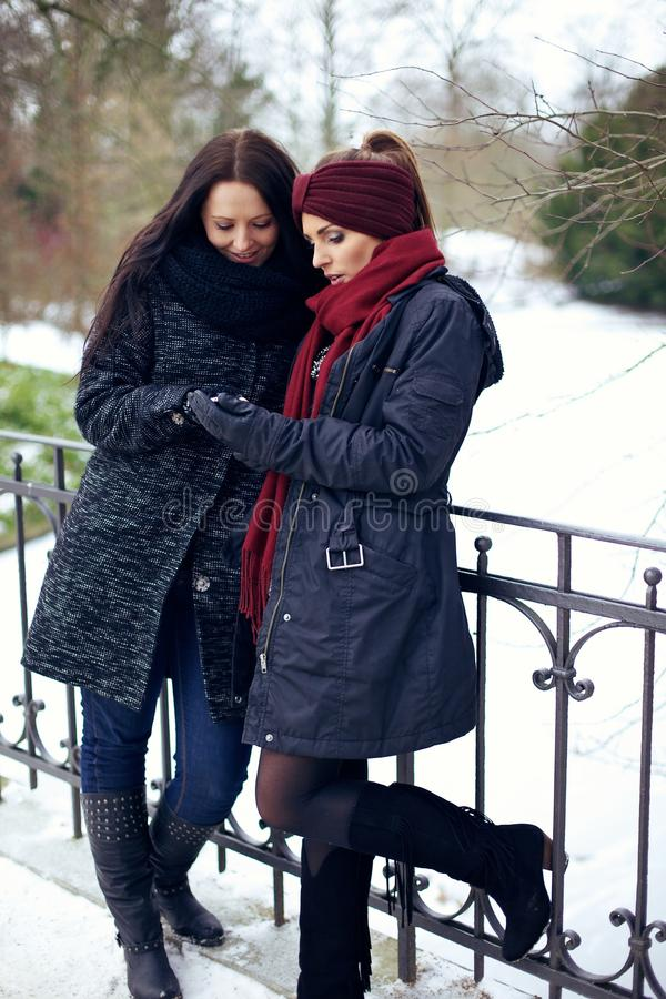 Download Young Women At Winter Park Looking At Something Stock Image - Image: 34384443