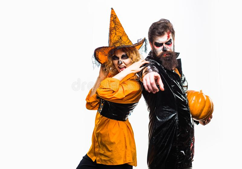 Young women witch in Halloween hat and bearded man over isolated background. royalty free stock photos