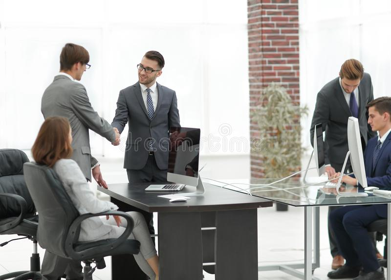The boss and the worker at work resolved the conflict. royalty free stock image