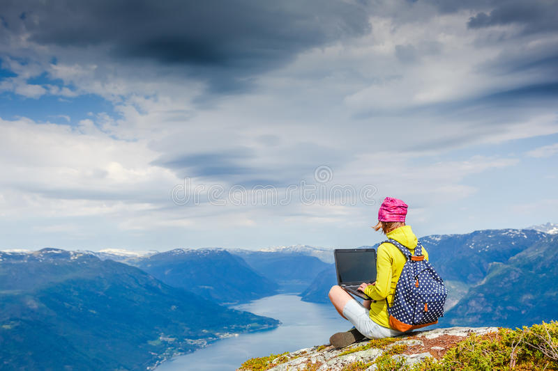 Young women working with laptop. Young woman working with laptop with beautiful nature landscape royalty free stock photography