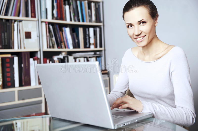 Young women works on a laptop royalty free stock photo