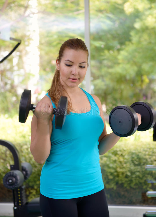 Young women wroking out in a Gym stock image