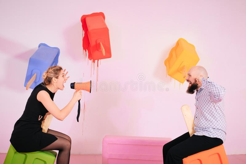 Young woman yelling at boyfriend in hysterics, drama queen screaming loud shouting at husband stock image