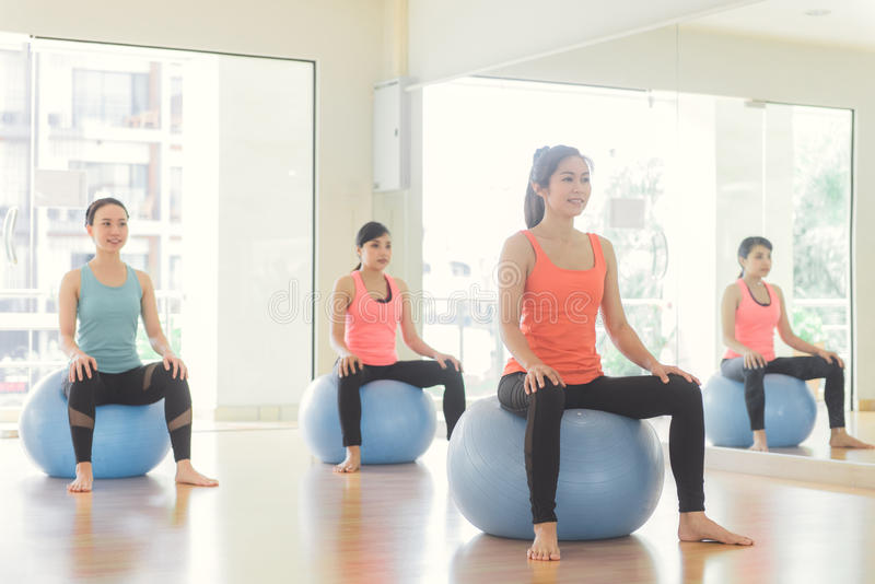 Young women yoga indoors keep calm and meditates while practicing yoga to explore the Inner Peace. royalty free stock images