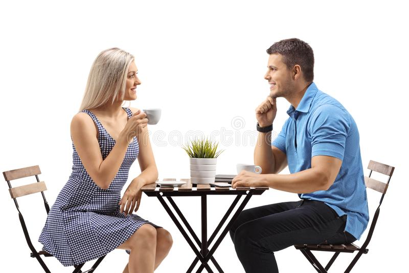 Young woman and a young man at a cafe stock photography