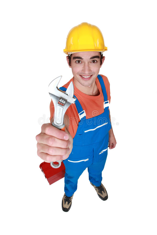 Worker with adjustable spanner. Young worker with adjustable spanner stock photography