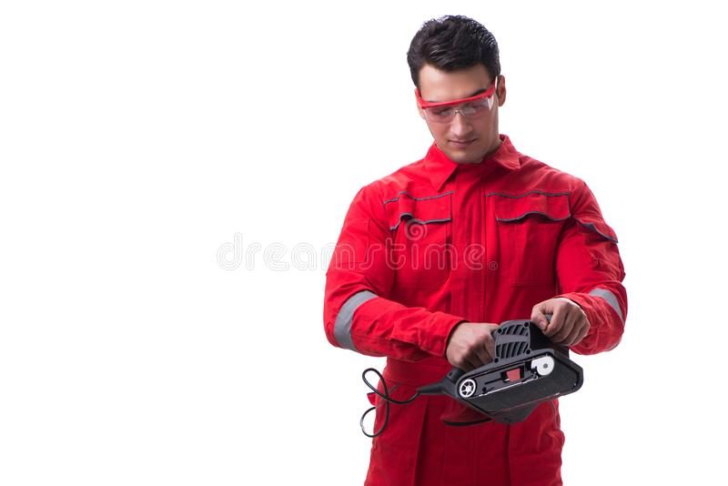 Young worker with belt sander sanding power tool isolated on whi royalty free stock image