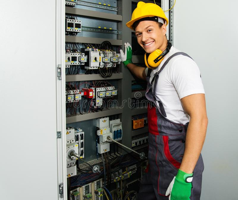 Young worker on a factory royalty free stock photos