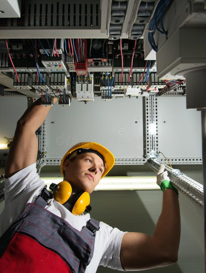 Young worker on a factory royalty free stock image