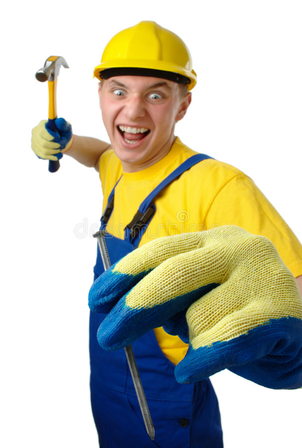 Young worker furiously hammering a nail. Isolated over white royalty free stock image