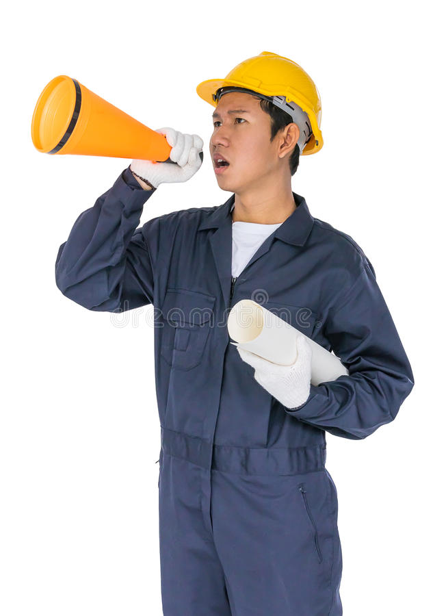 Young worker shouting for announce through a megaphone. Young worker with yellow helmet shouting for announce through a megaphone loud hailer isolated over white royalty free stock image